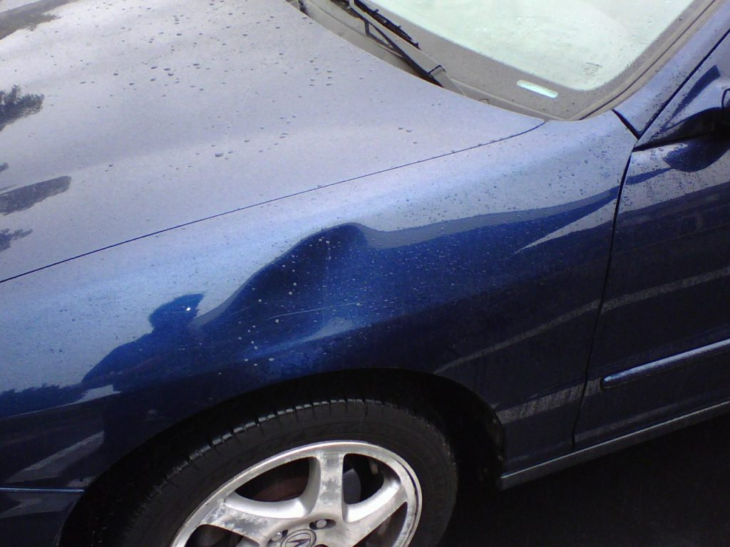 This car has a dent and is in need of Auto Dent Removal Service in OKC.